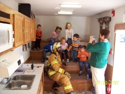Kids Learning from a Fire Fighter